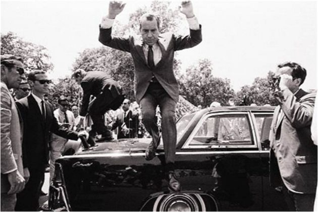 Nixon_jumps_off_car