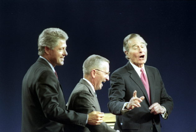 19 Oct 1992, East Lansing, Michigan, USA --- Presidential candidates Gov. Bill Clinton (L), Ross Perot (C), and President George Bush laugh October 19 after the conclusion of the third and final debate, held at the Wharton Center of Michigan State University in East Lansing. Mark Cardwell/Reuters --- Image by © MARK CARDWELL/Reuters/Corbis